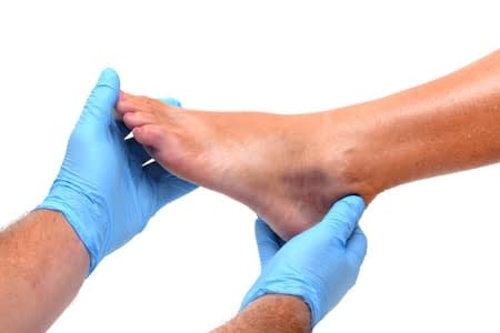 Doctor examines foot